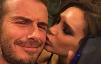 Victoria Beckham smooches David Beckham as he launches his whisky line