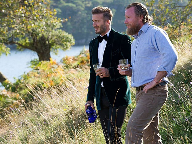 David Beckham and famous director Guy Ritchie (aka Madonna's former husband) on set in Scotland filming an ad for the Scottish liquor label.