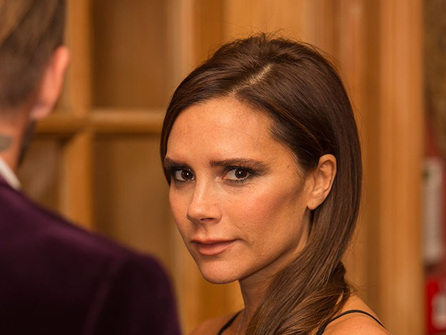 Victoria Beckham seen at the launch looking on dotingly at her husband David.