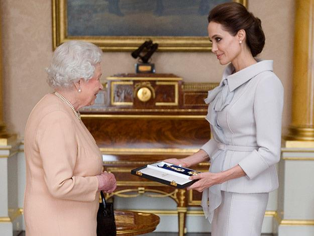 Angelina wore a dove grey suit by British couture house Ralph & Russo.