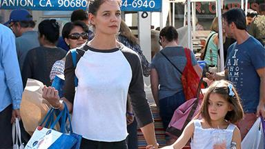 Suri shows off new haircut as she steps out with mum Katie