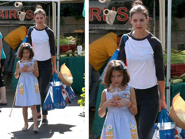 A casual Katie Holmes was out done by her daughter Suri who showed off her new haircut.