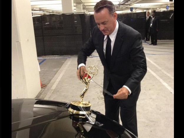 One time after winning an Emmy, Tom taped the award to the front of his car.