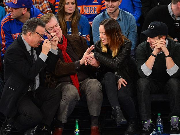 This hilarious pic shows the Captain Phillips star checking out actress Olivia Wilde's engagement ring!