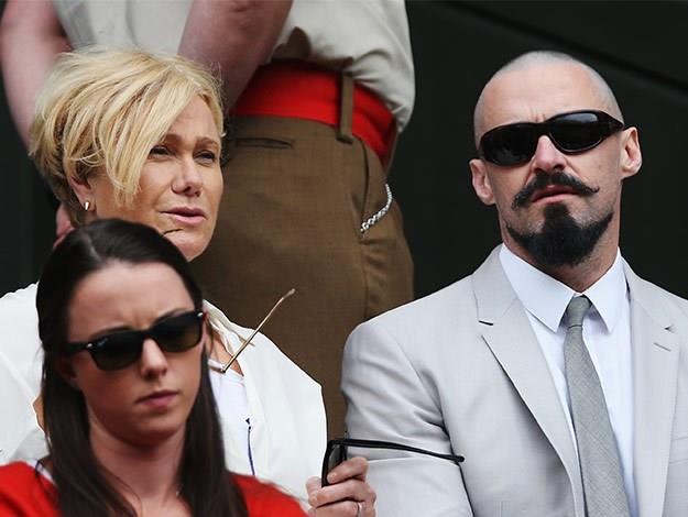 Hugh then spent most of the summer with his distinctive new look! Here he sat courtside at Wimbledon with Deborra-Lee.