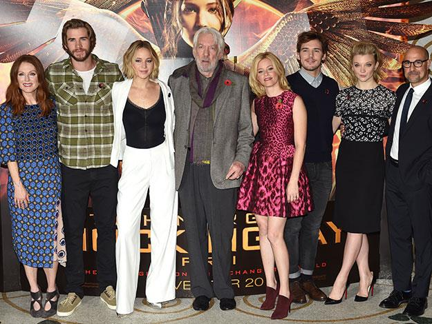 The cast (minus Josh Hutcherson) at a photocall the day before, where J-law again looked ravishing in white. From left to right: Julianne Moor, Liam Hemsworth, Donald Sutherland, Elizabeth Banks, Sam Claflin Natalie Dormer and Stanley Tucci.
