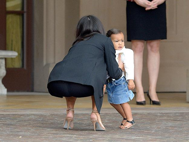 Adorable North West rocked a super-cute denim skirt, white jacket and black sandals to the low-key affair.
