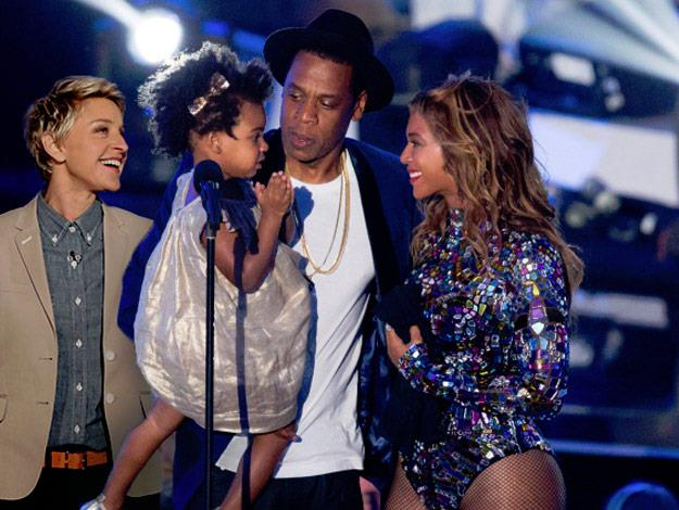 Ellen joins Jay Z and Blue Ivy on stage at the VMAs to present Beyonce with the Michael Jackson Video Vanguard Award.