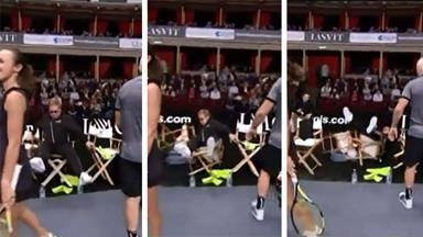 Elton John falls off chair at Tennis