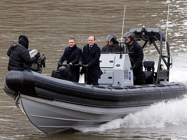 Daniel Craig was seen making a splash on London's River Thames as he filmed new scenes for the upcoming James Bond film alongside co-star Rory Kinnear.