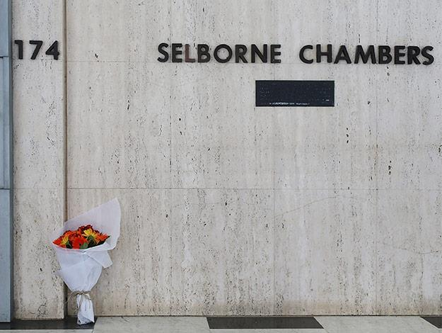Flowers are left in front of Selborne Chambers door as a sign of respect to deceased hostage Katrina Dawson.