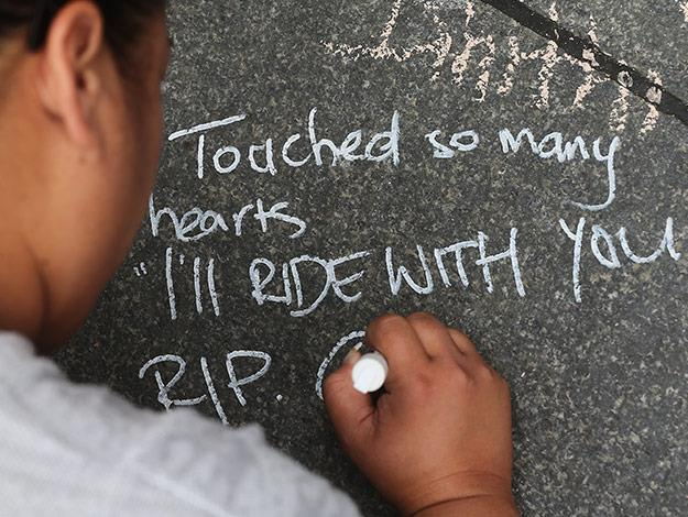 Condolence messages are written on the pavement as a sign of respect at Martin Place.