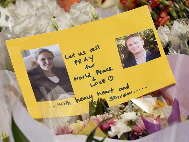 A heartfelt card shows photos of Katrina Dawson (L) and Tori Johnson (R) - the two hostages killed during the fatal Sydney siege.