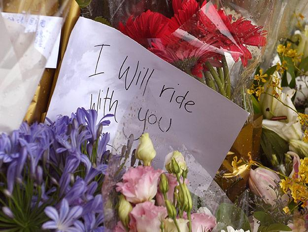 Messages are left on flowers at the floral memorial.