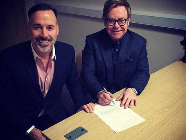 After two decades together, the happy couple sign their marriage papers!