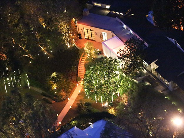 A view of Cameron Diaz's garden all lit up for the wedding celebrations as the famous guests partied inside.