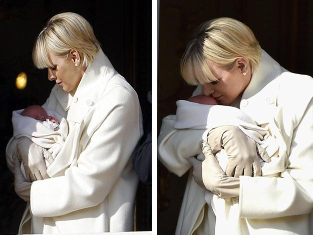 Princess Charlene plants a gentle kiss on her daughter.