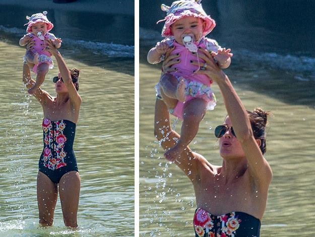 Jodi and Aleeia splashing around. It looks like they are having a 'Lion King' moment!