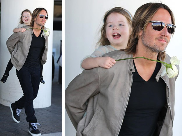 Faith is a spitting image of mum, Nicole. The cutie couldn't stop giggling as Keith carried her around.