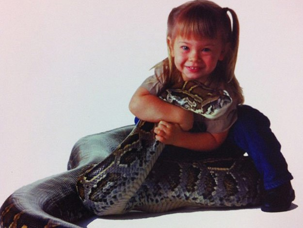We remember when Bindi was a little girl! And she enjoyed spending time with her pet snake, Bazzle!