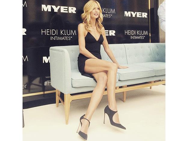 Posing in the store windows, the leggy blonde showed off why she's still one of the world's highest paid models!