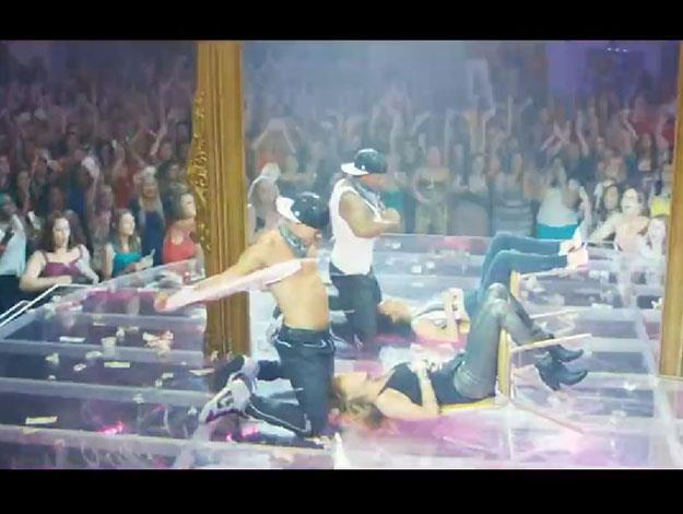 The boys rip off their shirts onstage as they perform for a massive screaming crowd.