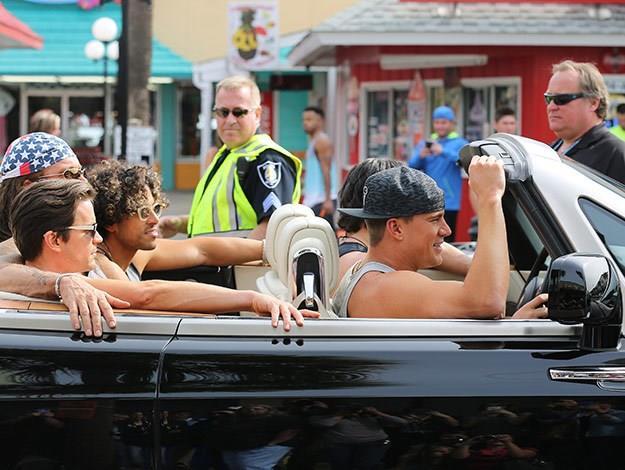 The boys cruising in a convertible