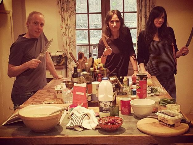 Dave posted this snap of Liv in the kitchen with pals at New Years - no hard partying when you're an expectant mum!