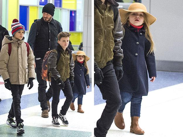 Harper looked positively adorable in a big floppy hat when she was spied jetting into New York with her brothers and Daddy David ahead of her mum's show.
