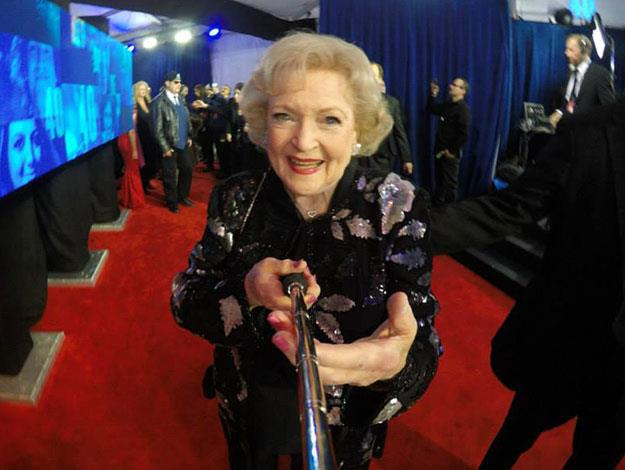 Comedic legend Betty White, 93, has fun with a selfie stick on the red carpet.