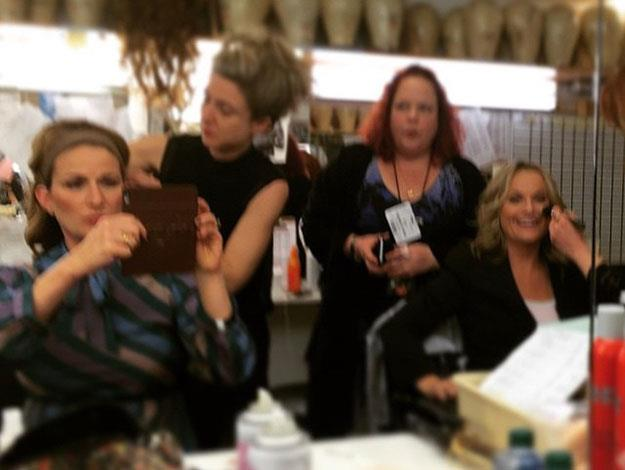Amy Poehler and Ana Gasteyer have busy blurry moment backstage amidst makeup mayhem.
