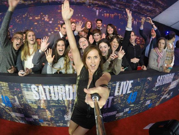 Molly Shannon uses a selfie stick to pose with fans.