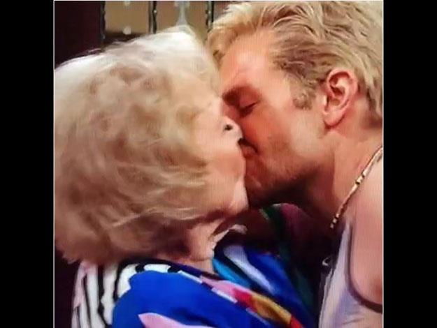 Bradley Cooper and Betty White kiss passionately onscreen during the SNL 40th anniversary show!