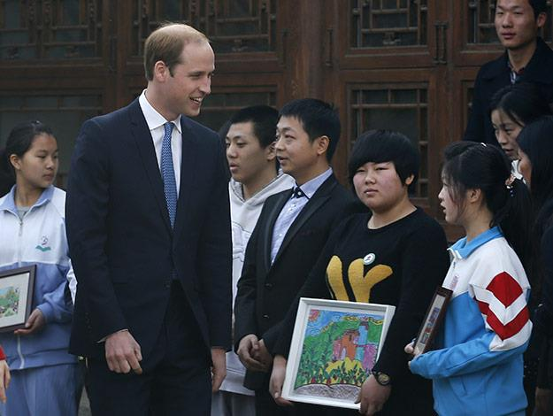 Prince William meets the locals in Beijing. He even got the chance to show off his limited grasp of the language, greeting locals with 'Ni Hao'.