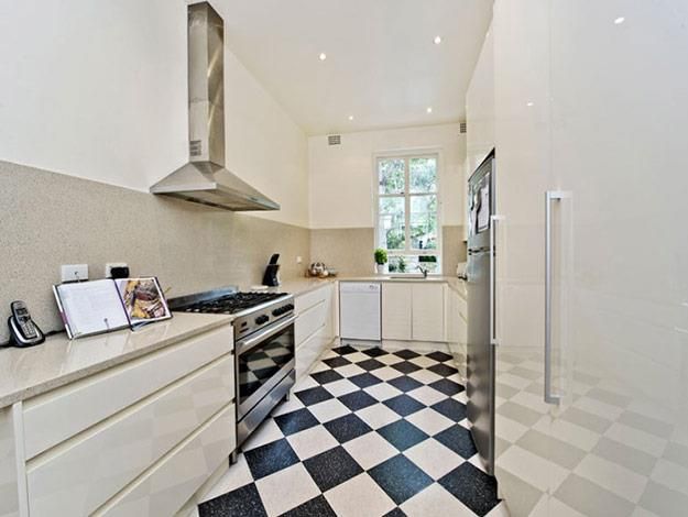 We're guessing this is Manu's favourite room, the stunning French-inspired kitchen. Look at those counter-tops and checkered floors!