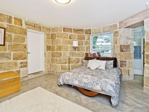 The exposed brick in the bedroom looks wonderfully rustic, giving the room a lovely feel.