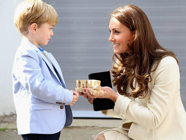 From one George to another! Actor Oliver Barker who plays George on the show, presents the Duchess with a toy train for Prince George.