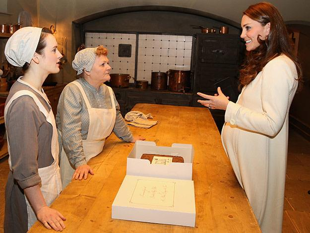 Catherine, the Duchess of Cambridge meets actresses Sopie McShera and Lesley Nicol in the Downton Abbey kitchen.