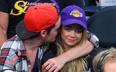 Sarah Hyland caught on kiss cam with new beau Dominic Sherwood!
