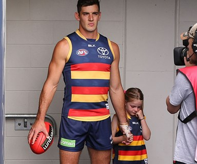 Aussie footballer Taylor Walker comforts teary little girl