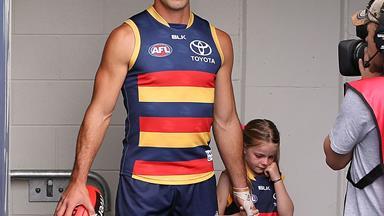 Aussie footballer Taylor Walker comforts teary little girl