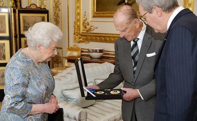 Queen Elizabeth presents Prince Philip with Australian knighthood
