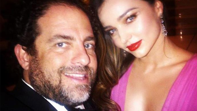 Miranda Kerr cuddles up to James Packer's good pal fuelling speculation their clandestine romance is still on