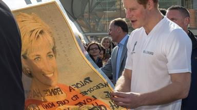 """Prince Harry is presented with a photo of late mother Diana as he says he's """"very happy"""" being single"""