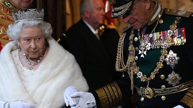 So in love! Queen Elizabeth holds hands with Prince Philip as she opens British Parliament