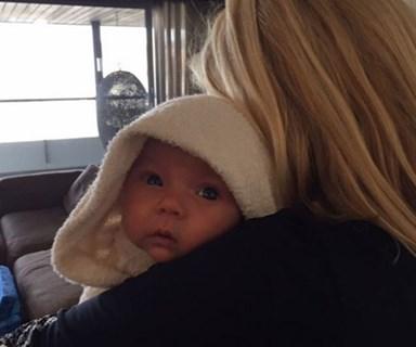 Shane Watson's daughter Matilda is snug in Nanna's arms