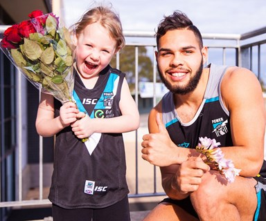 This little girl gets her dream proposal from AFL Port Adelaide player, Jarman Impey