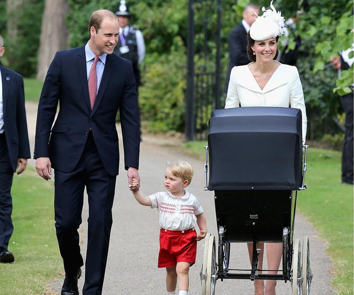 The Duchess of Cambridge pushes Princess Charlotte in her pram, accompanied by the Duke of Cambridge and little Prince George.