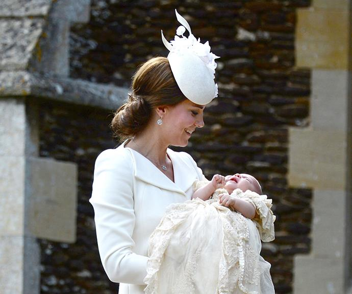 Catherine holds Princess Charlotte close outside the church.