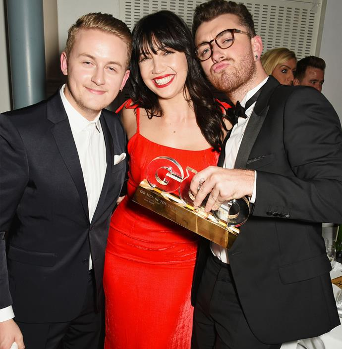 Music producer Guy Lawrence, model Daisy Lowe and Sam Smith cuddle up for a group shot after the awards. Photo: Getty